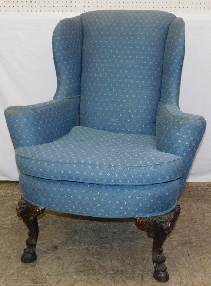 Carved base Gothic type wing chair.