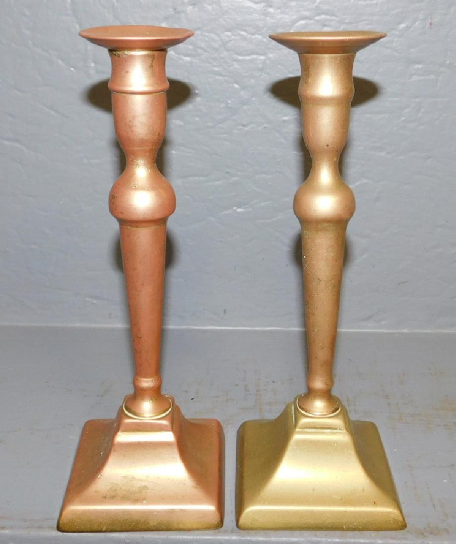 Pair of 19th C brass candlesticks.