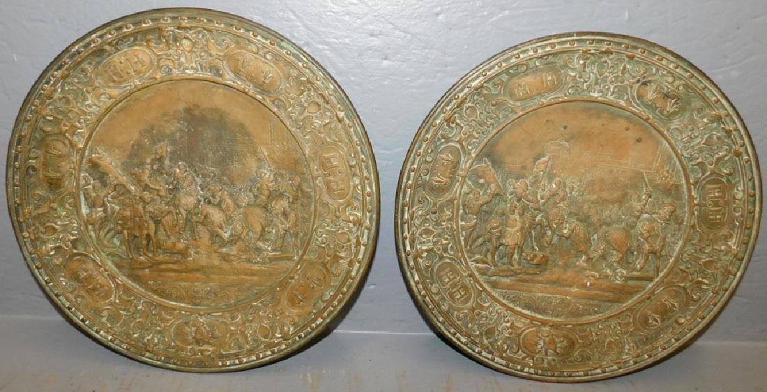 2 bronze signed .H.H. battle scene plaques
