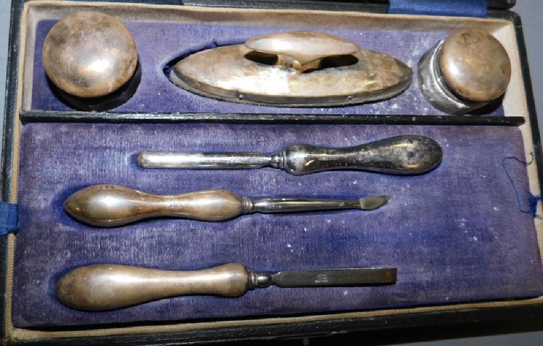 Sterling handle and top grooming kit.
