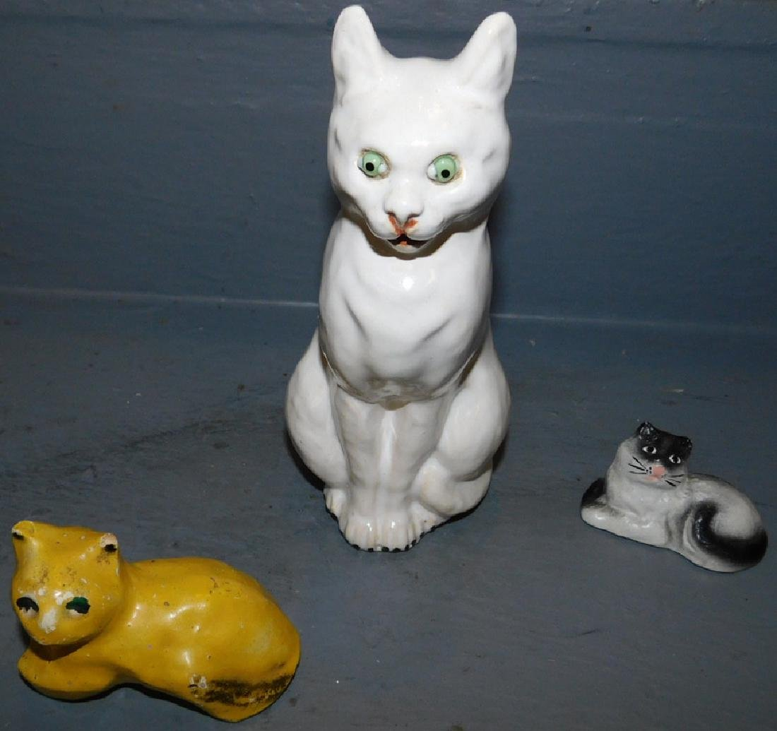 2 porcelain cat figures and cast iron cat.
