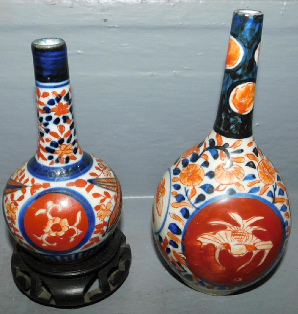 Pair of small Imari barber bottles.