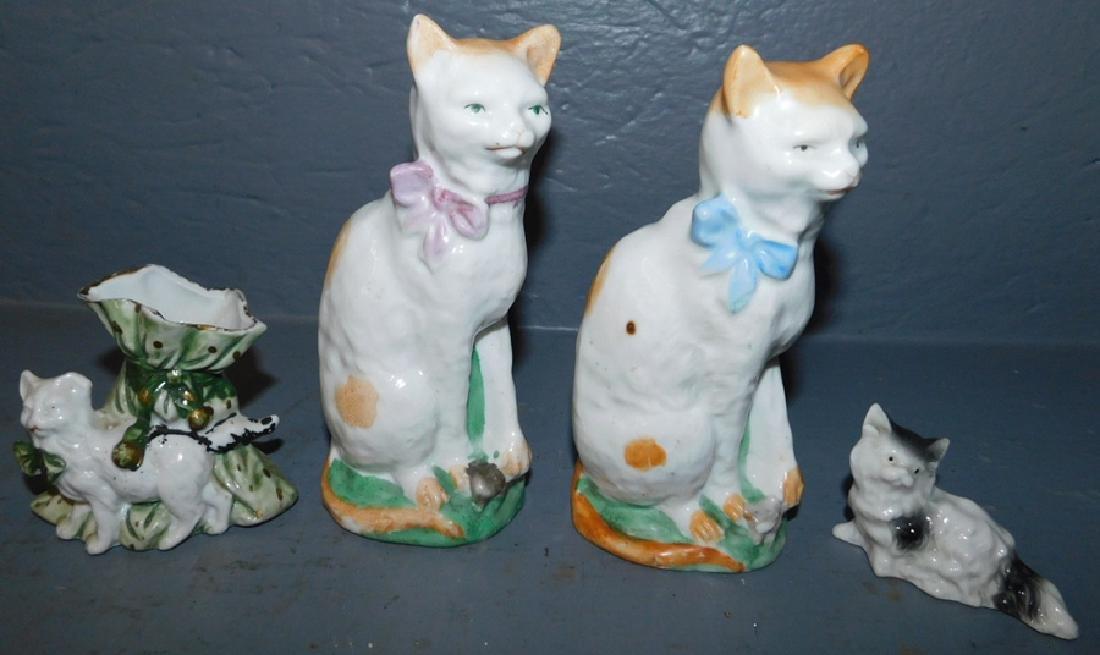 4 porcelain cat figures.