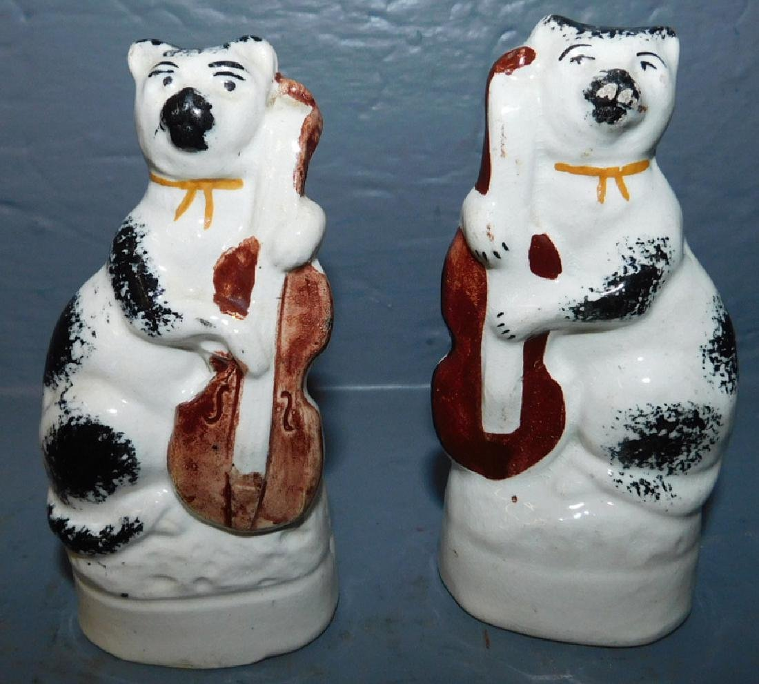 Pair of early Staffordshire musician cats.