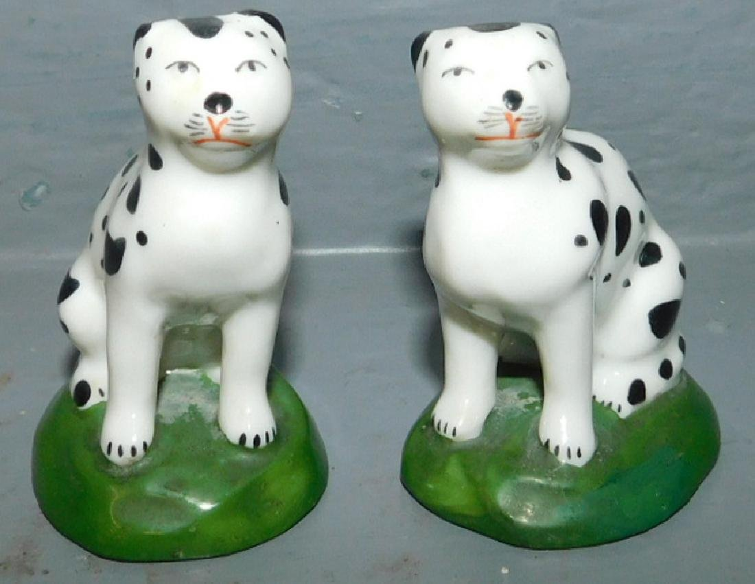 Pair of Chelsea cat figures.