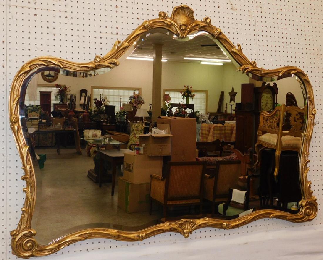 Farmville estate gold leaf framed beveled mirror.