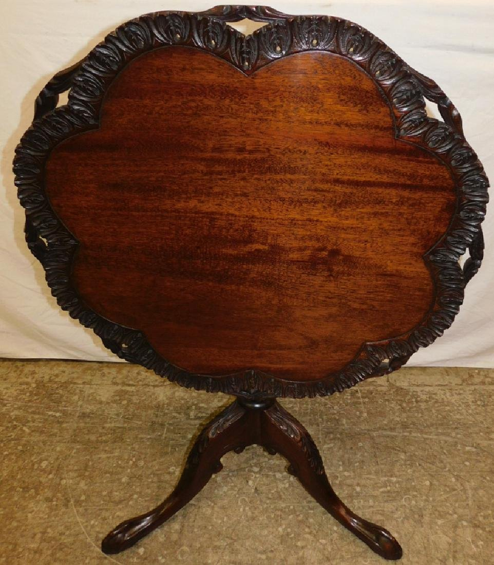 Piecrust ball and claw foot tilt top table.