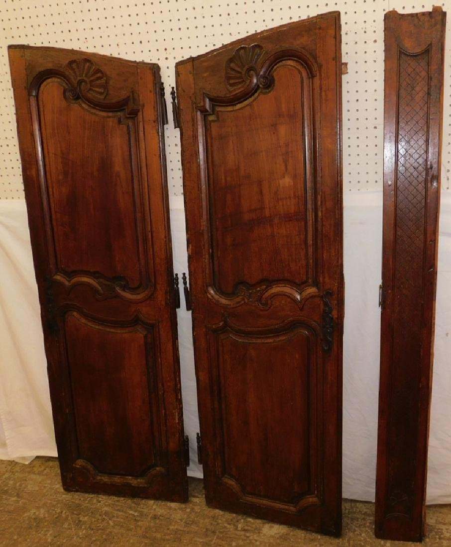 Pair of 18th C carved walnut doors.