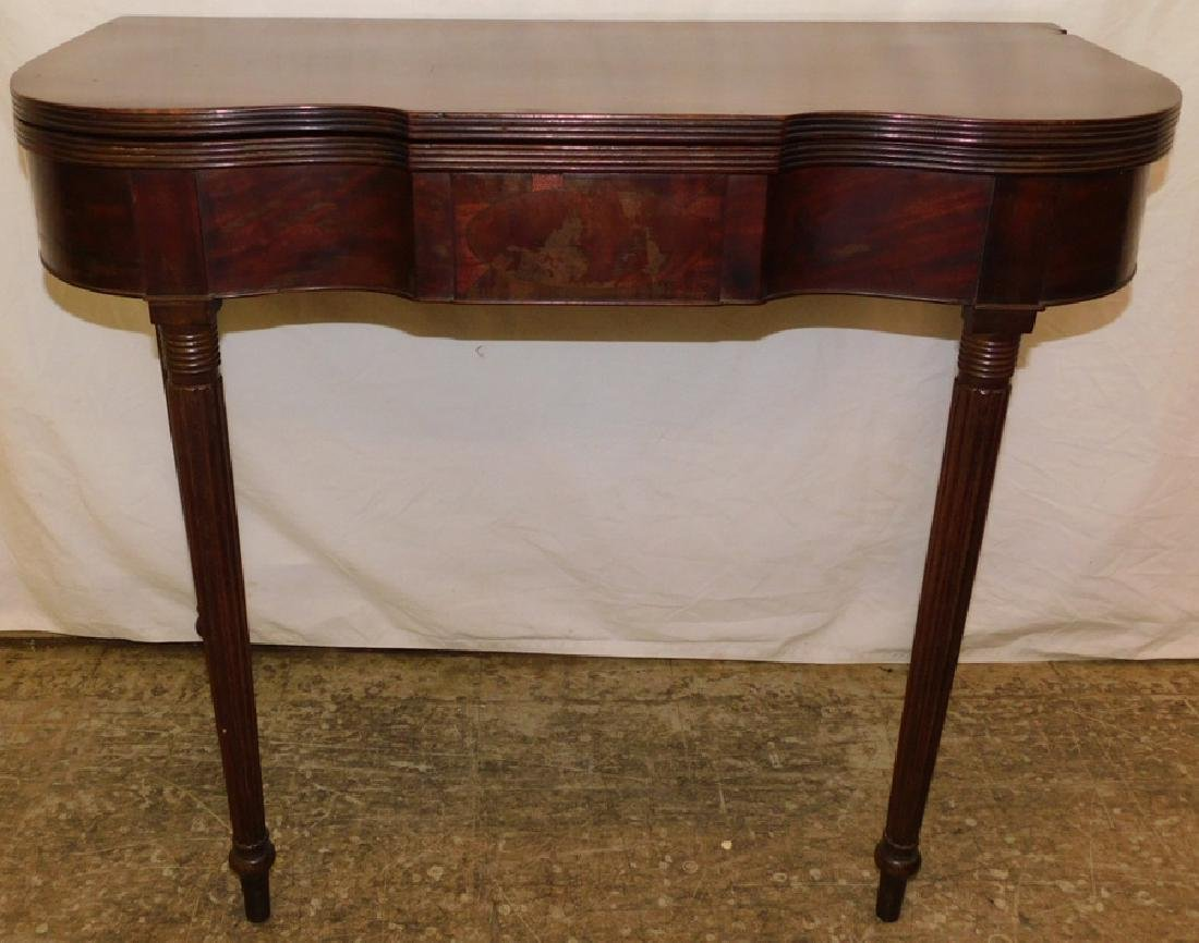 Sheraton period mahogany fold over game table.