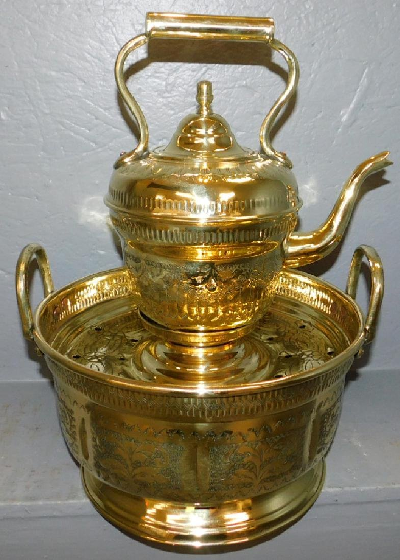 Polished brass brazier and kettle.