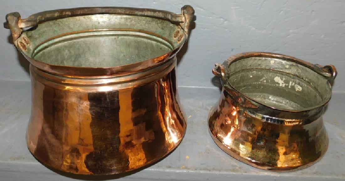 2 polished copper pots.