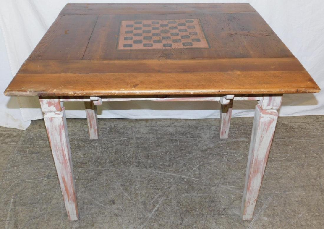 Primitive pine work table with checkerboard top.