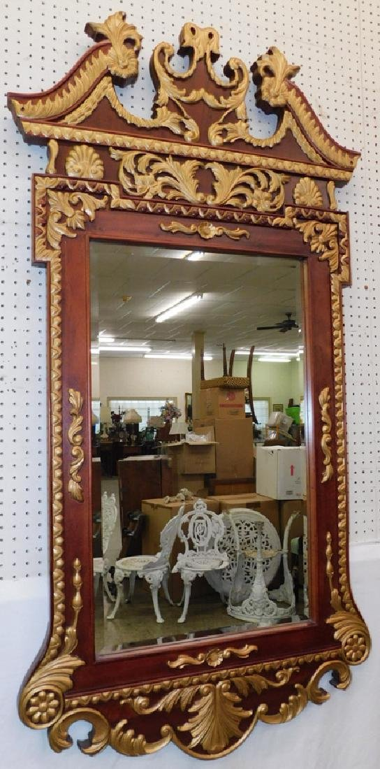 Gold decorated Chippendale style beveled mirror.