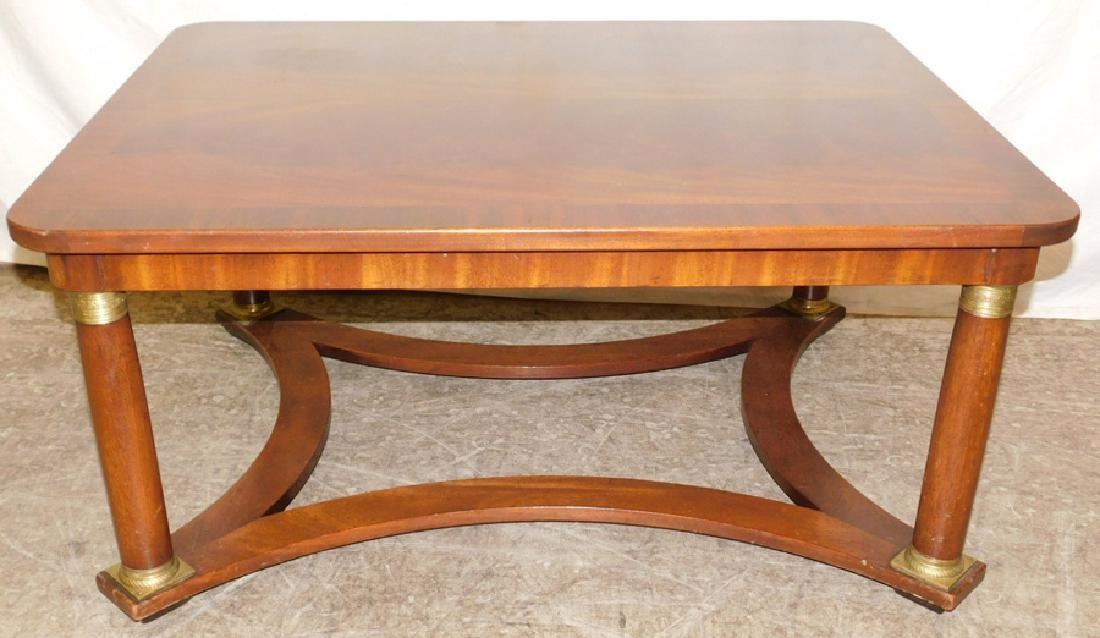 Baker flame grain mahogany top tea table.