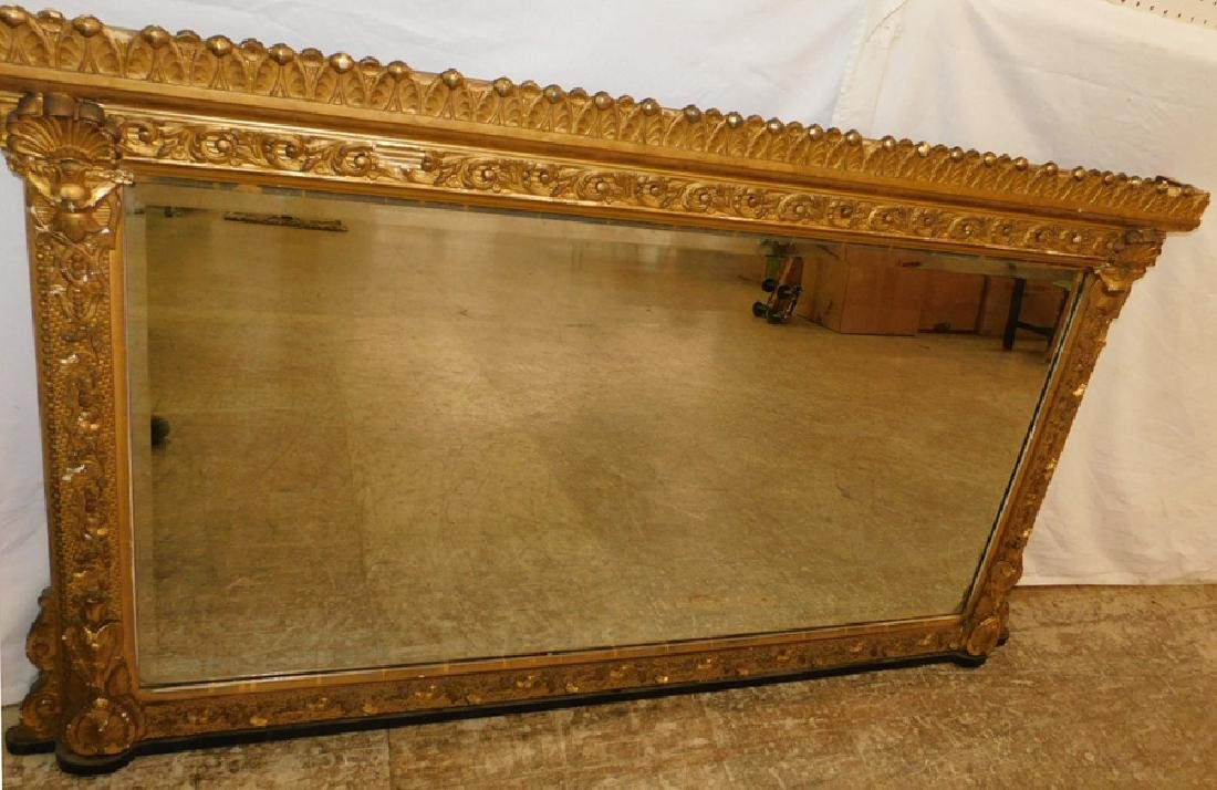 Gilt framed over mantle mirror.