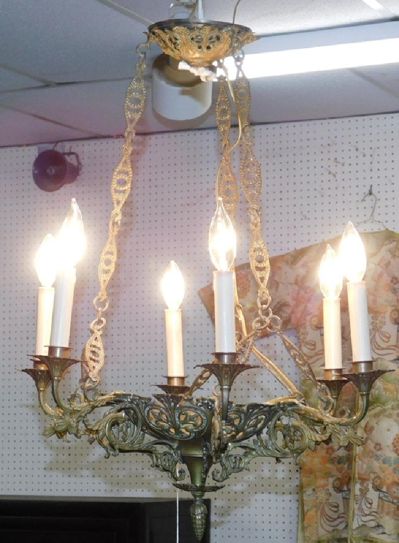 6 light cast brass chandelier.