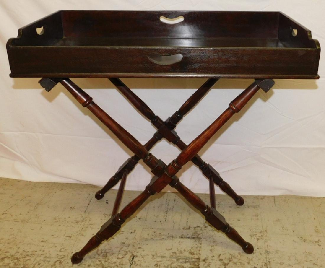 Mahogany butlers tray on stand.