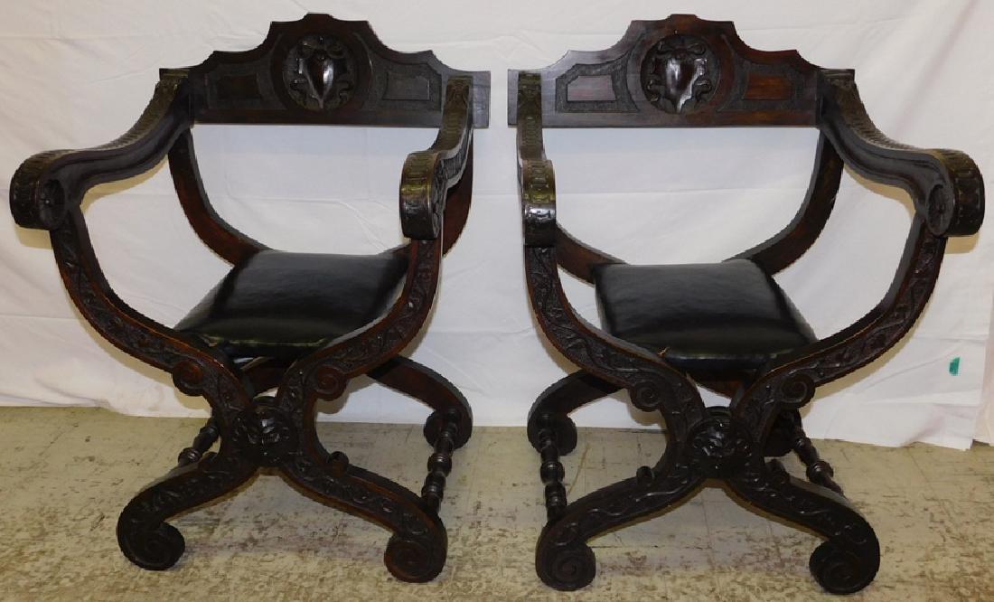 Pair of Italian walnut Savonarola chairs.