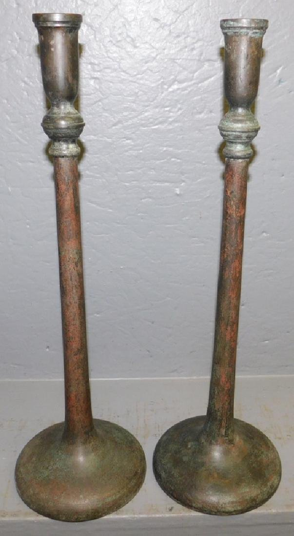 Pair of bronze or metal candlesticks.