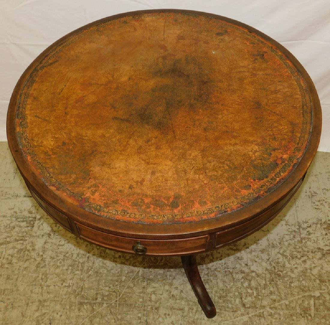 Antique tooled leather top drum table. - 2
