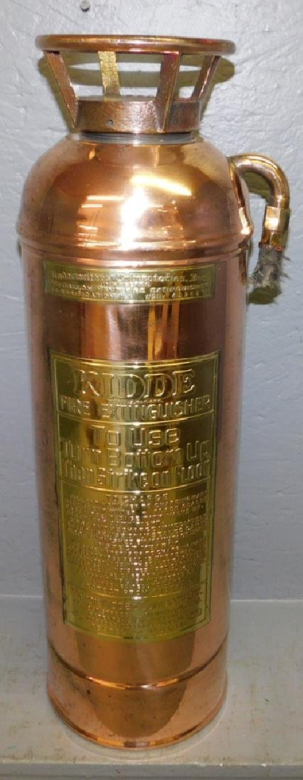 Polished copper fire extinguisher.