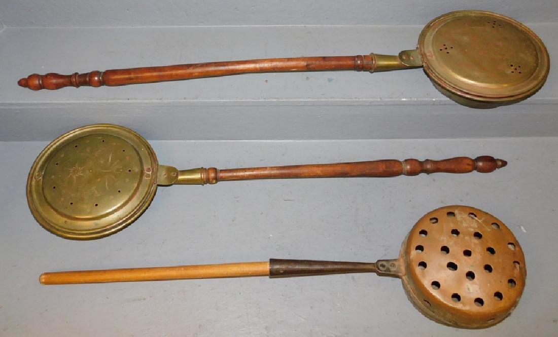 2 Early brass bed warmers, copper chestnut roaster