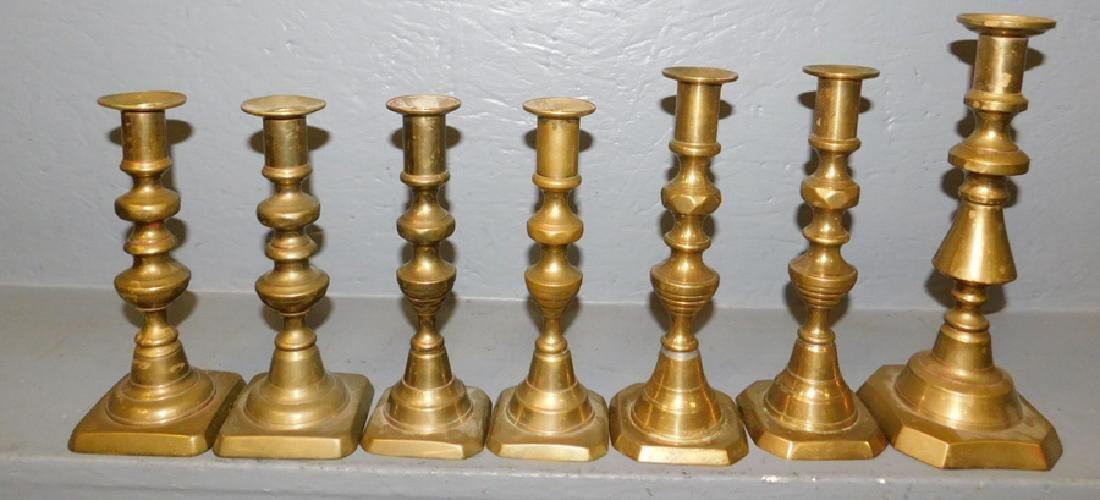 Seven 19th C brass candlesticks.