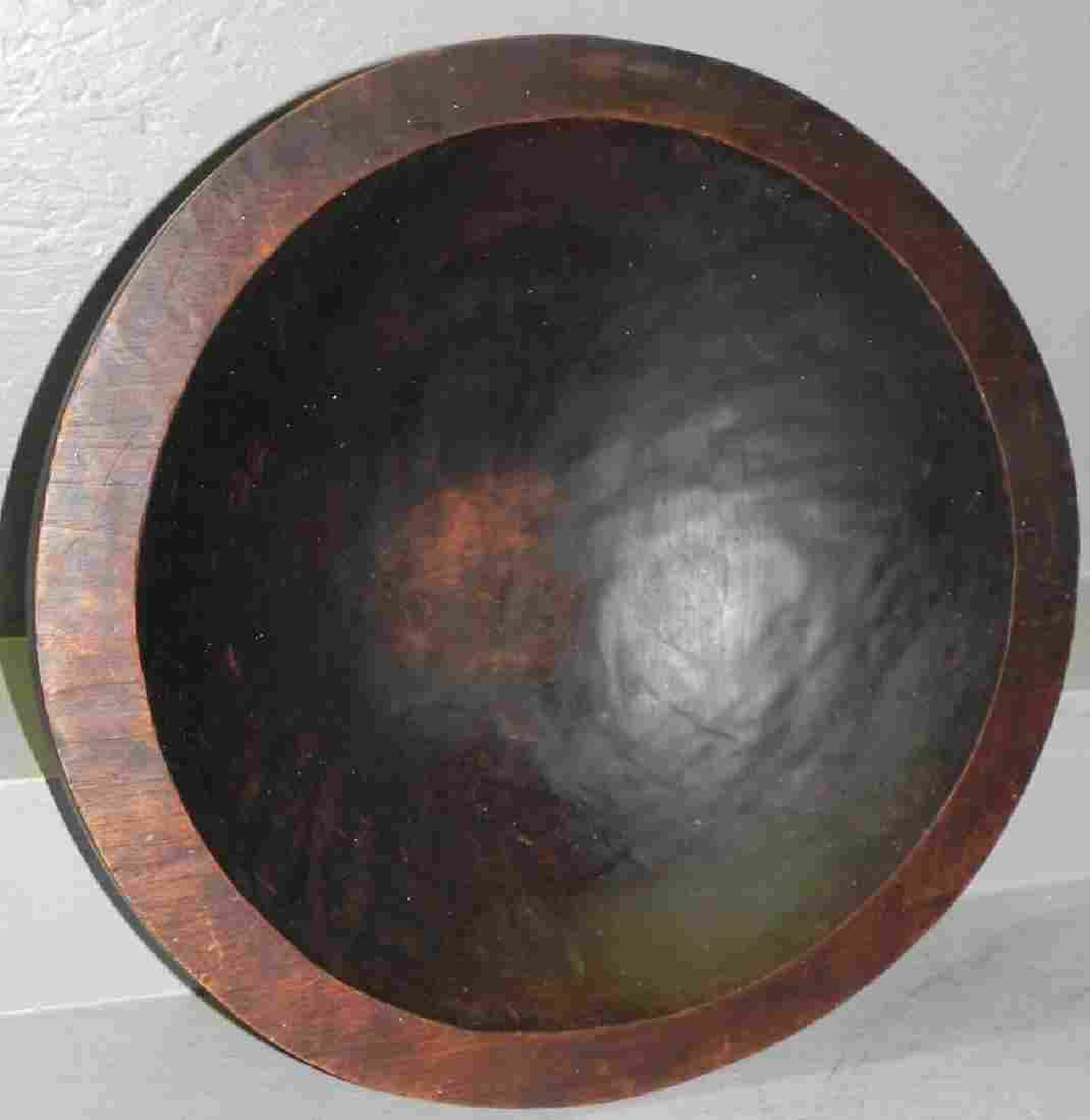 Large wooden mixing bowl.