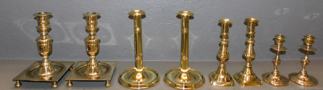 Four pair brass candlesticks.