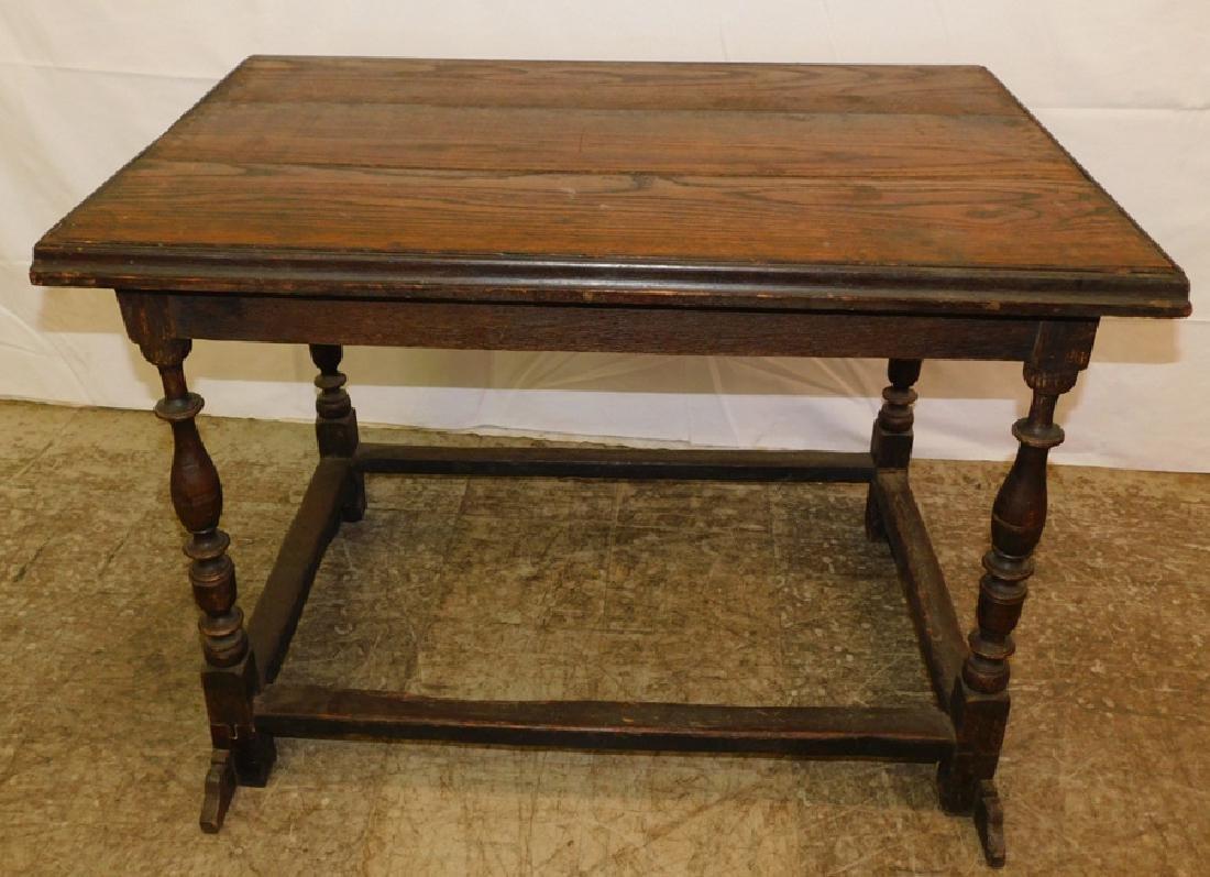 English oak stretcher base table.
