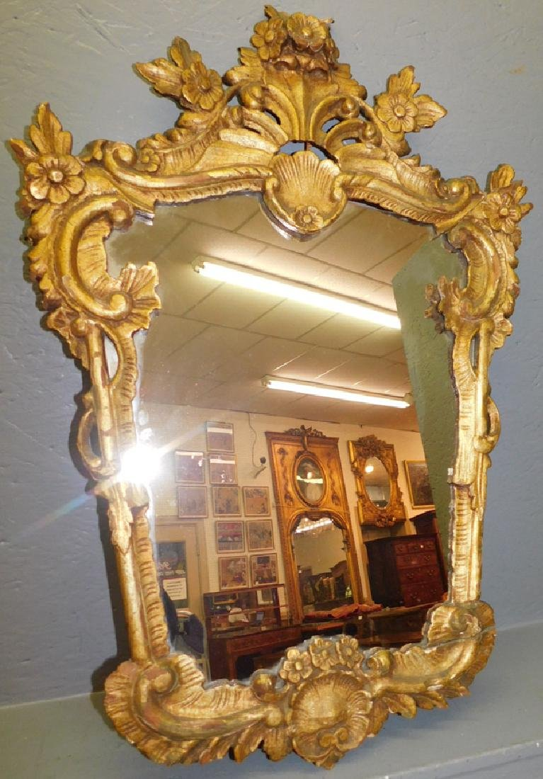 18th C carved giltwood mirror.
