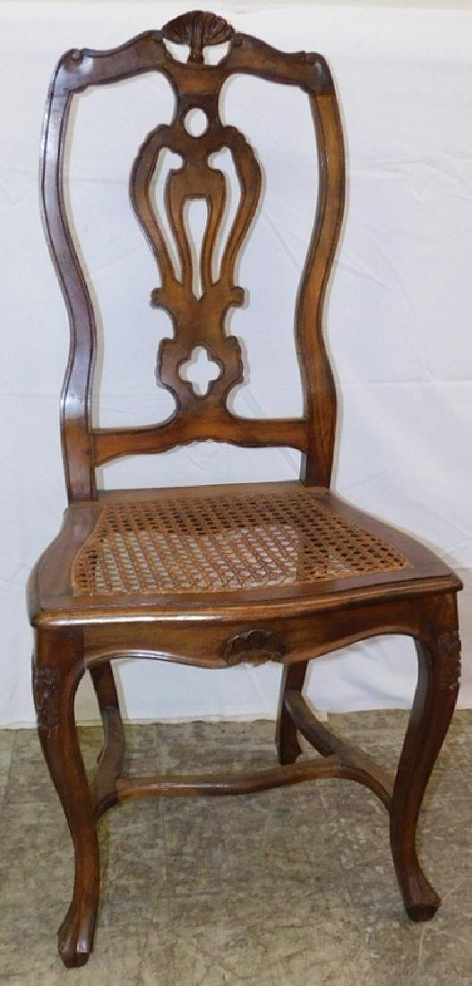 French walnut cane bottom carved side chair