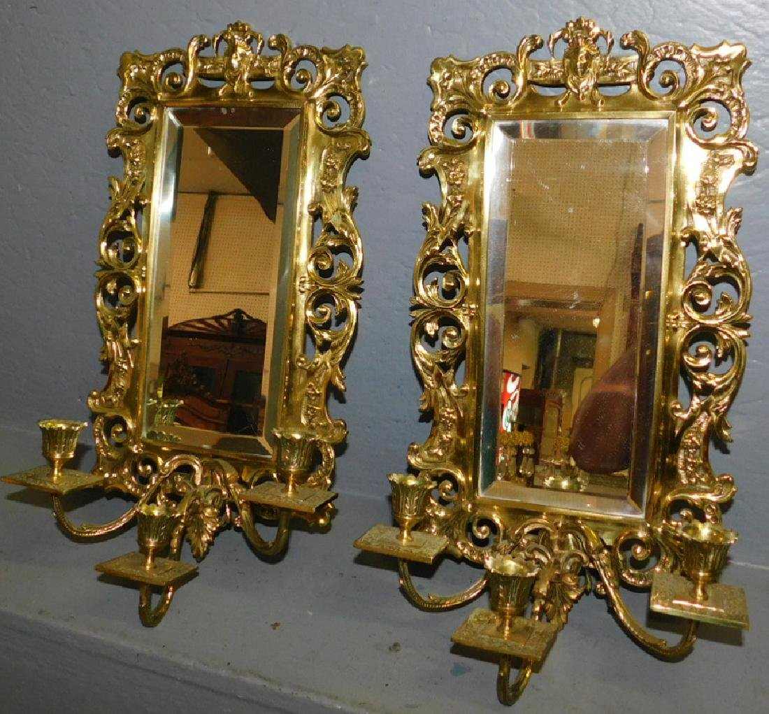 Pair of jellif head mirrored wall sconces.