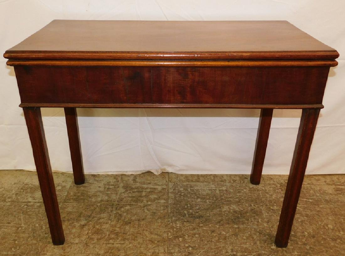 Mahog. fold over Chippendale game table