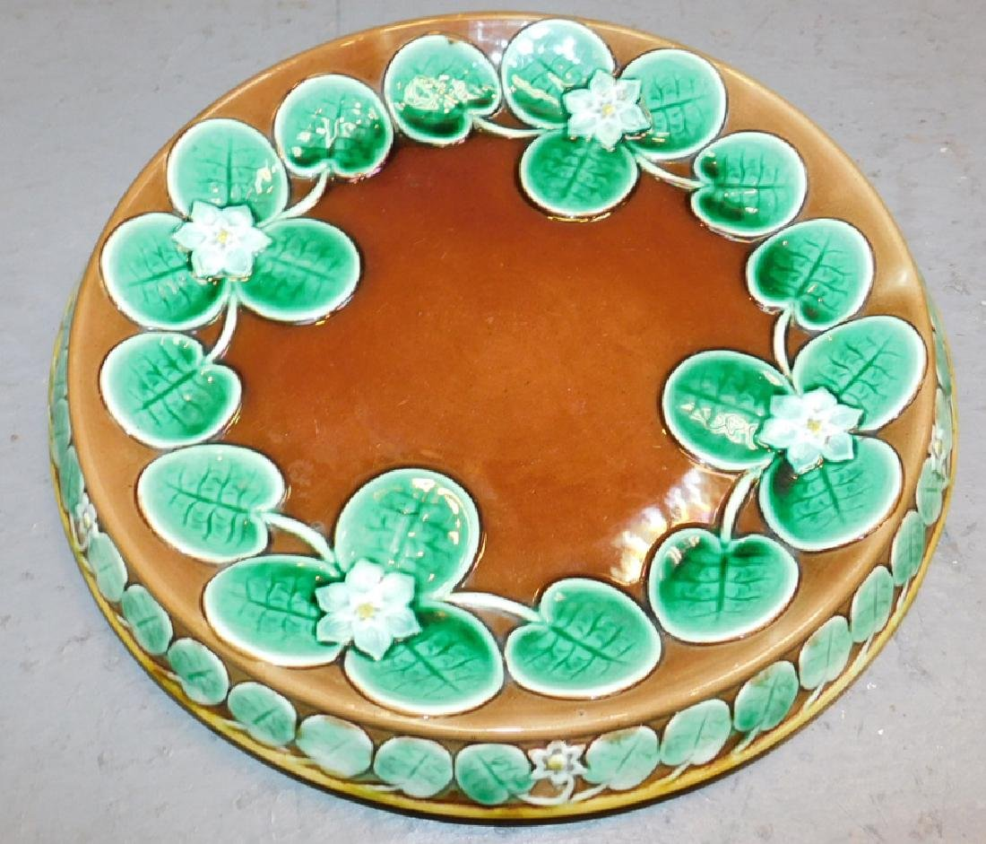 Majolica cake plate with lily pad decoration.