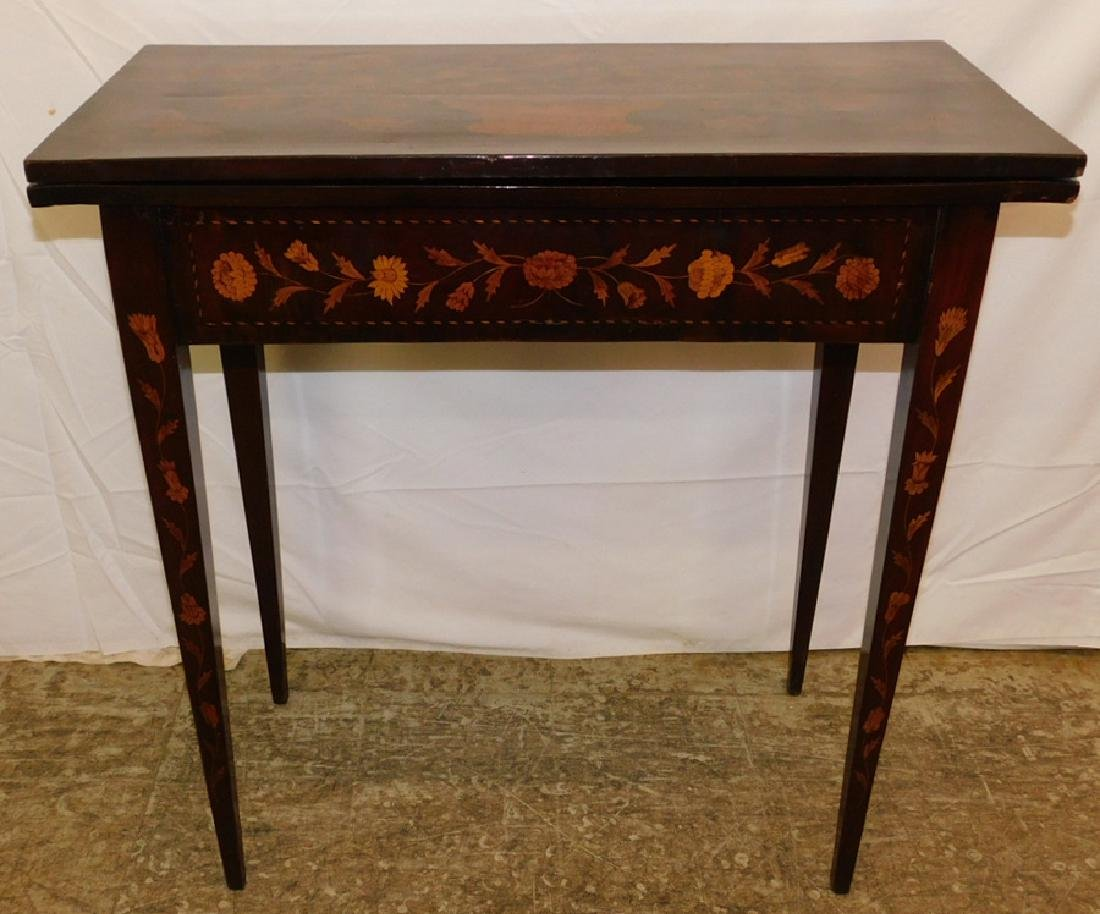 Marquetry inlaid Dutch mahogany game table.