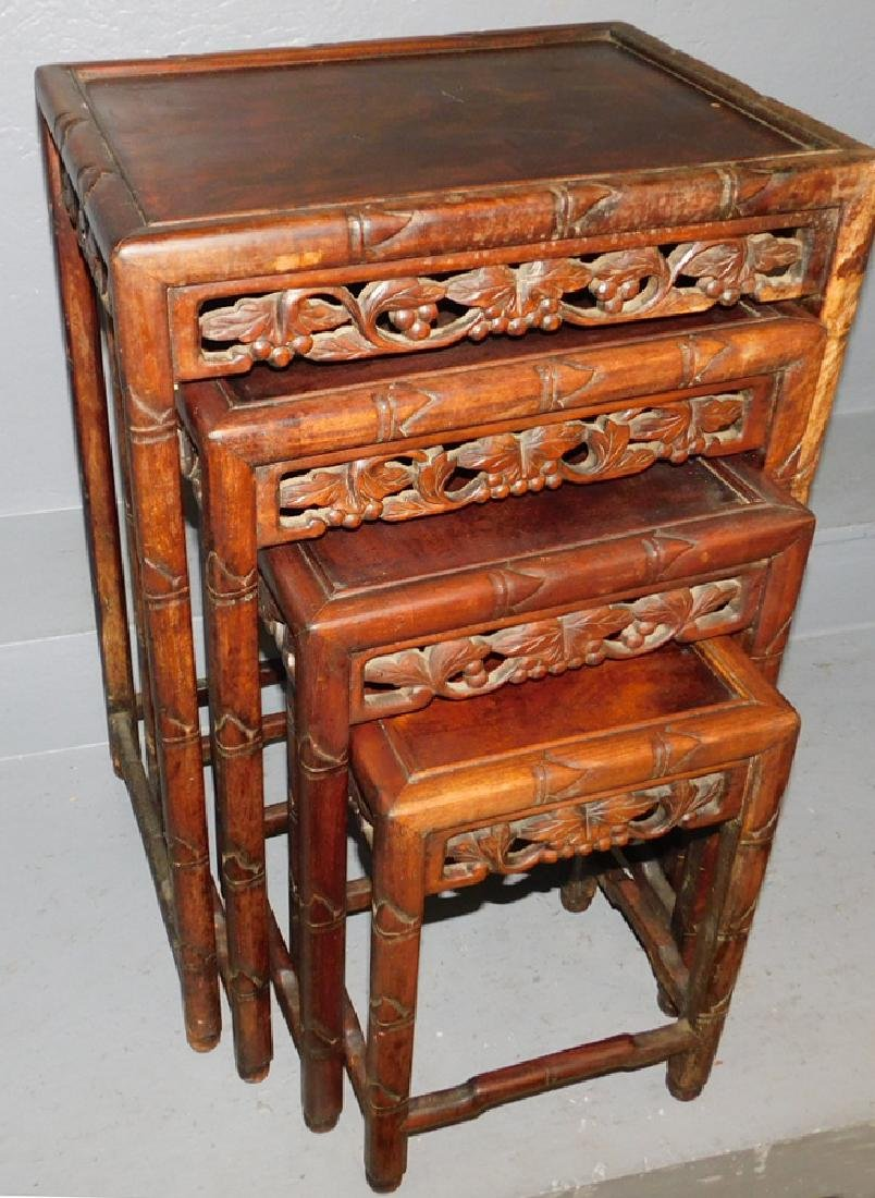 Teakwwood set of 4 nesting tables.