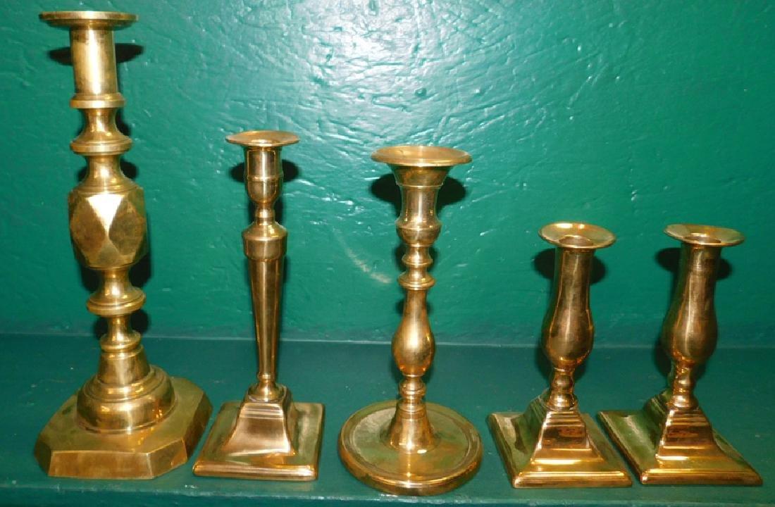 Five Antique Brass Candlesticks