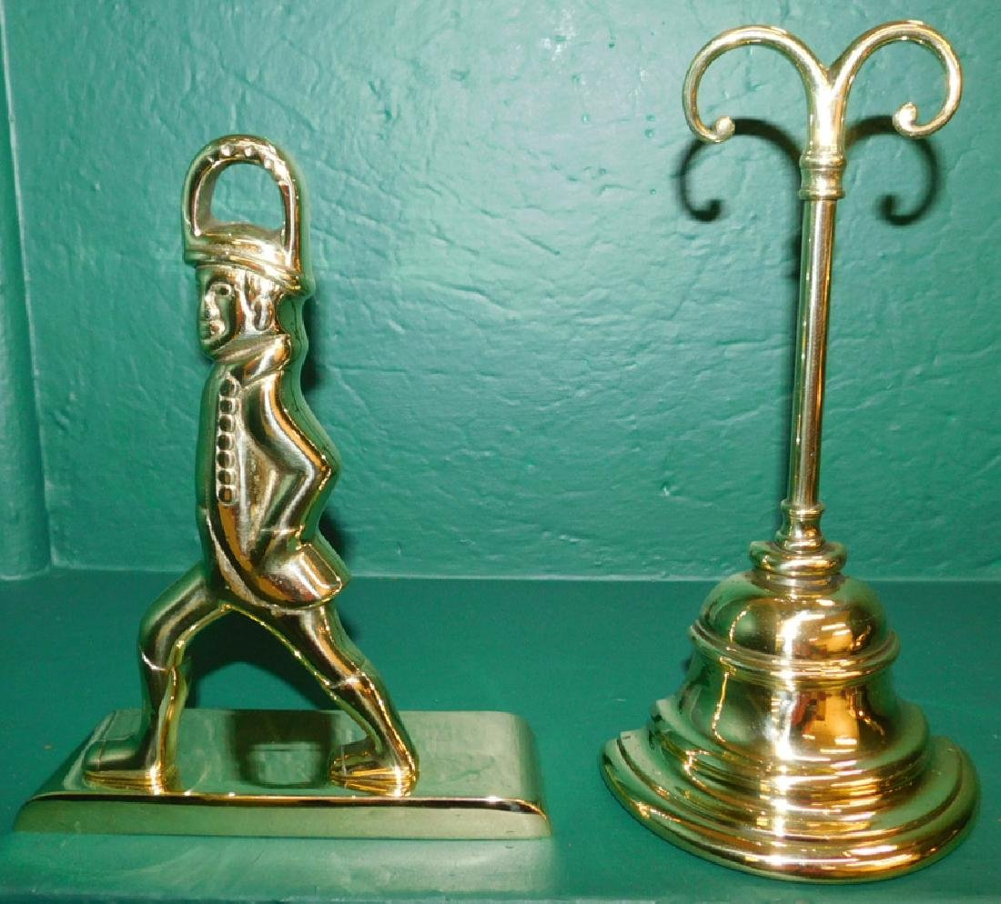 Two Polished Brass Doorstops