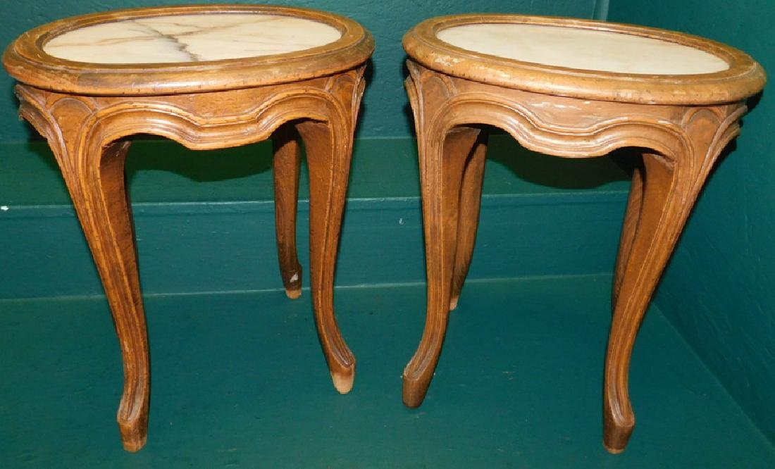 Pair of French oval marble top stands