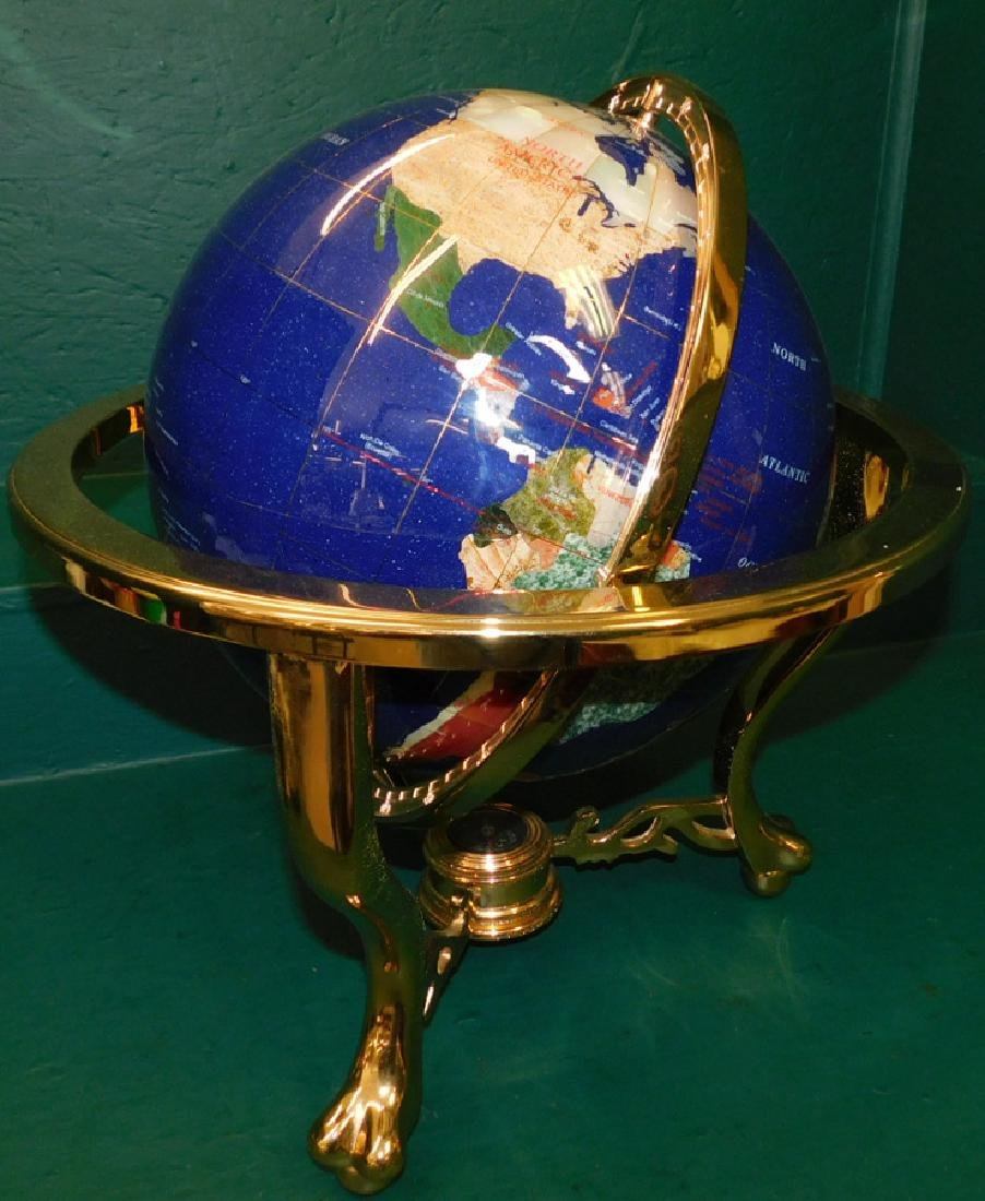 Modern globe with brass frame