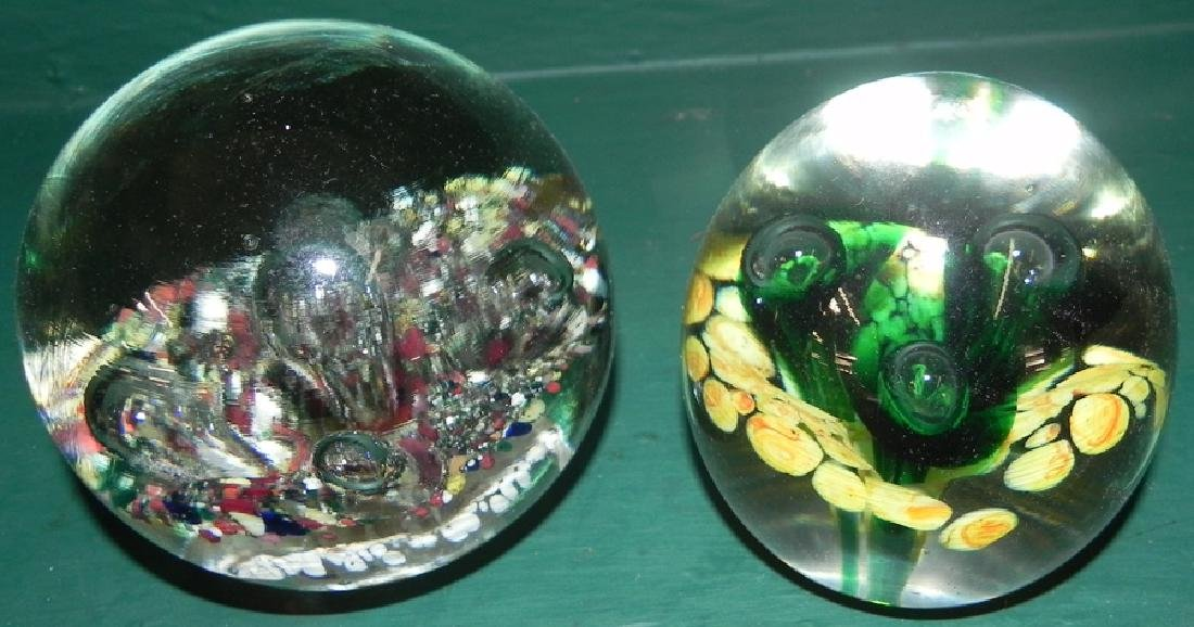 2 glass paper weights
