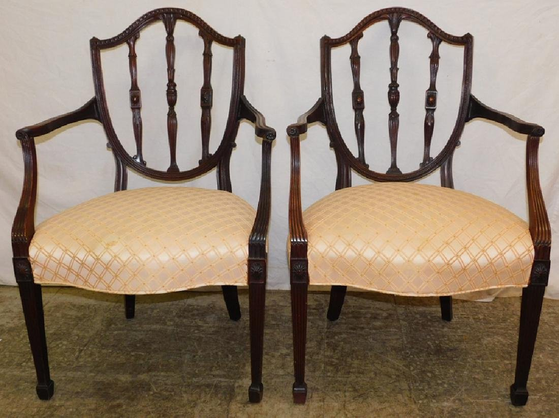 Pair of Hepplewhite shield back arm chairs