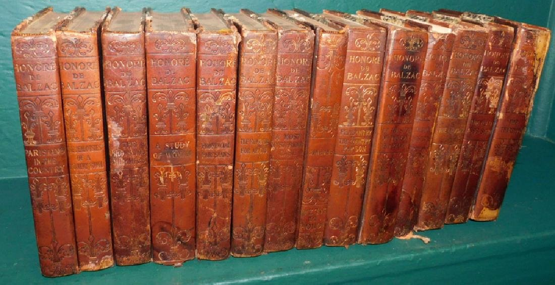 14 leather bound books in as found condition