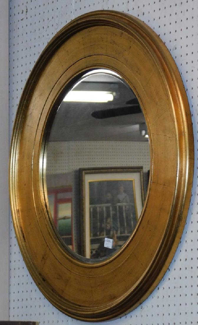 Gold frame round bull's eye mirror