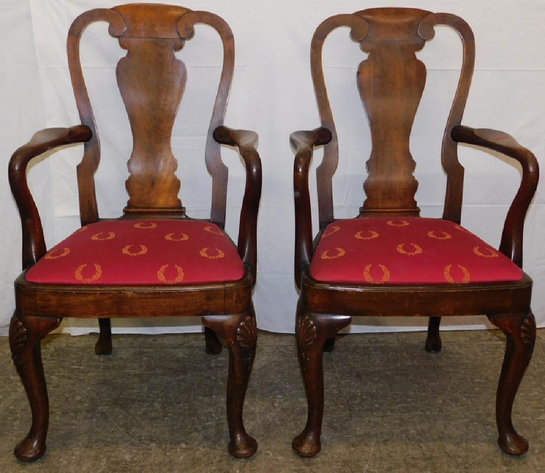 Pair of walnut Queen Anne arm chairs