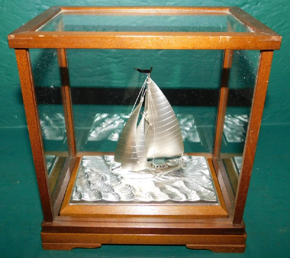 Sterling silver sailboat in case by Takehiko Seki