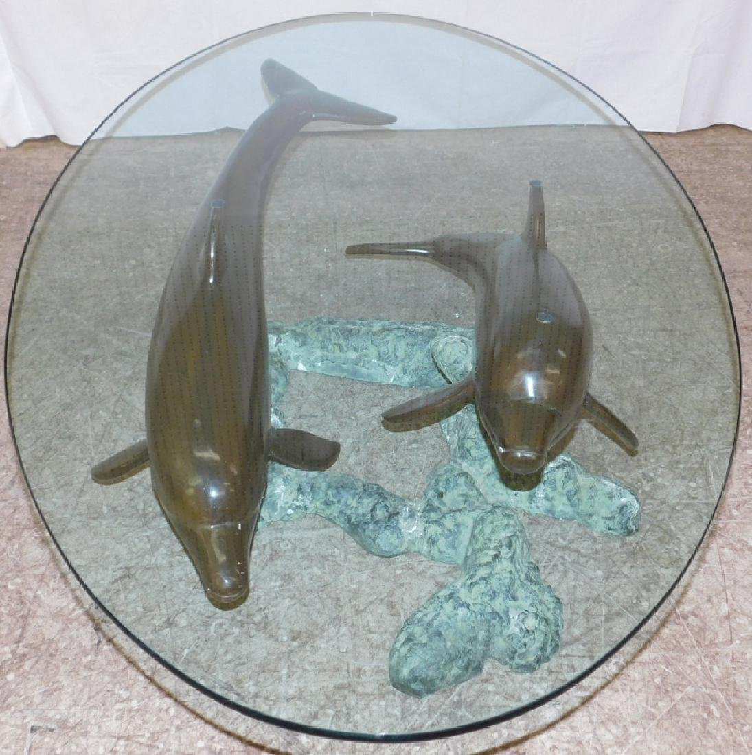 Glass top bronze dolphin coffee table