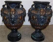 Pair of bronze ornate urns