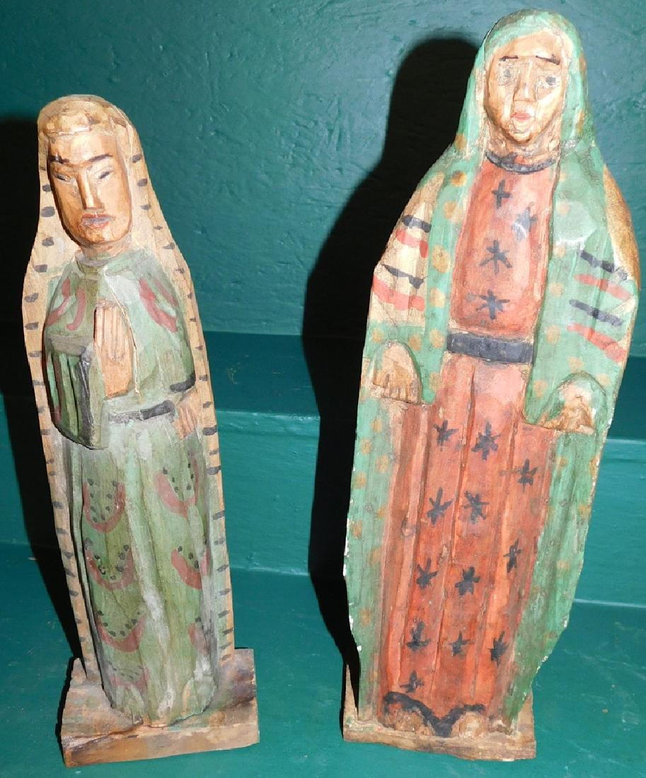 Two Carved Santos